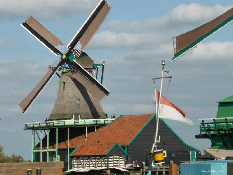 Visit Zaanse Schans to see windmills, clogs and eat cheese.