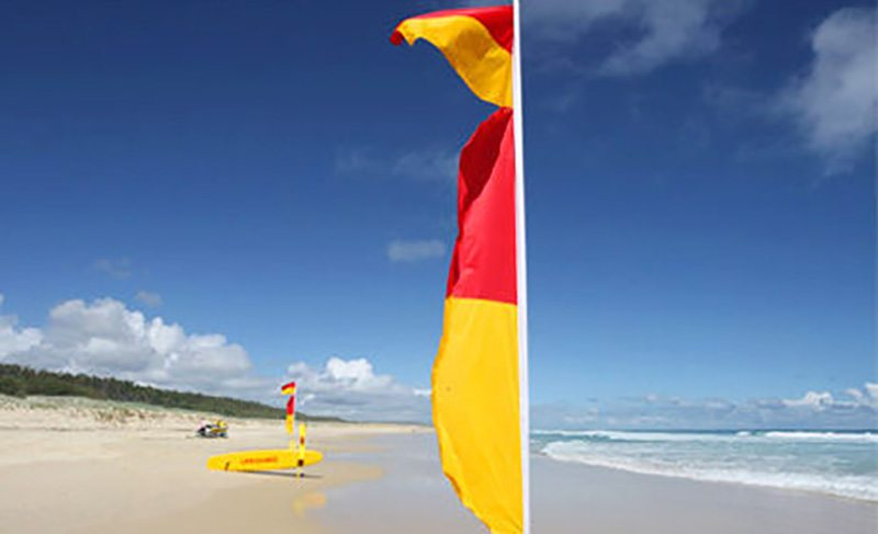 Swim between the bloody flags on Australian beaches
