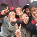 a group of young Japanese boys Why Do Many Asians Use the V or Peace Sign in Photographs