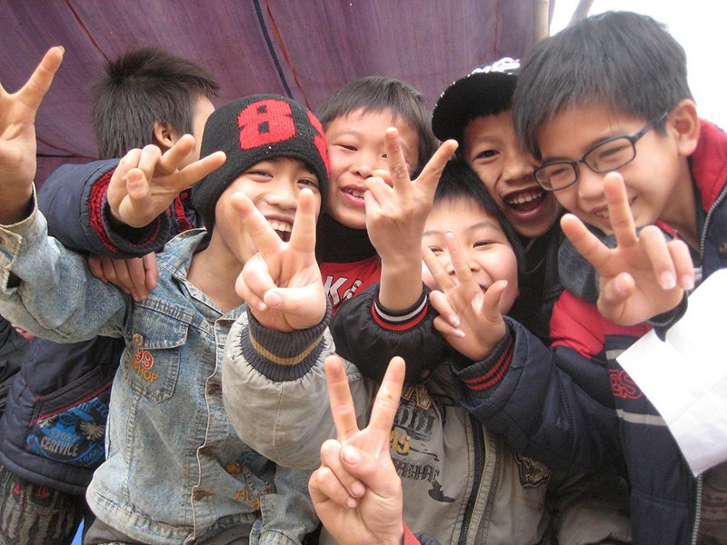 Why Do Many Asians Use the V or Peace Sign in Photographs?