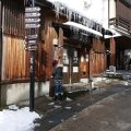 A pretty lady rubs an onsen seal during An Onsen Crawl in Nozawa Onsen