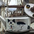 A kettle with a cat painted on it are Art made from Recycled Materials in Japan